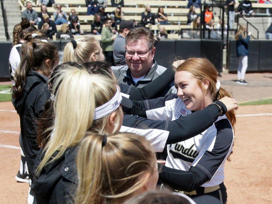 Purdue senior Mallory Baker (2) embraces her teammates during senior night ceremonies, Sunday, April 28, 2019 at Bittinger Stadium in West Lafayette.