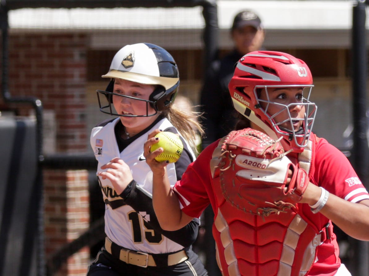 Purdue short stop Rachel Becker (15) runs past Wisconsin catcher Taylor Johnson (21) to attempt to score during the third inning of a NCAA softball game, Sunday, April 28, 2019 at Bittinger Stadium in West Lafayette. Wisconsin won, 4-1.