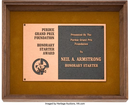 Neil Armstrong received this plaque in 1975 for being an honorary starter at the Purdue Grand Prix. It is among Purdue-related items from the Armstrong Family Collection, now up for auction.