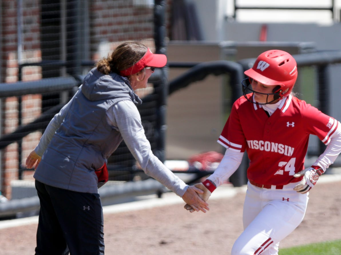 Wisconsin short stop Lauren Foster (24) high fives Wisconsin head coach Yvette Healy after hitting a solo home run during the fourth inning of a NCAA softball game, Sunday, April 28, 2019 at Bittinger Stadium in West Lafayette. Wisconsin won, 4-1.
