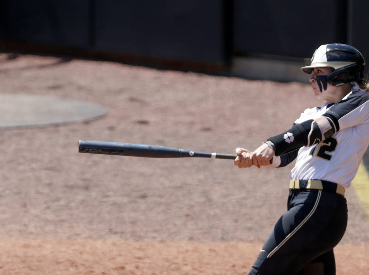 Purdue third baseman Jenny Behan (12) connects during the sixth inning of a NCAA softball game, Sunday, April 28, 2019 at Bittinger Stadium in West Lafayette. Wisconsin won, 4-1.