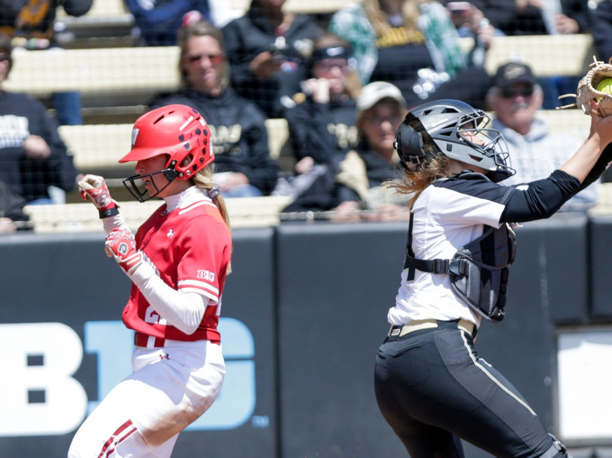 Wisconsin outfielder Gabby Scherle (22) beats the ball to score during the fifth inning of a NCAA softball game, Sunday, April 28, 2019 at Bittinger Stadium in West Lafayette. Wisconsin won, 4-1.