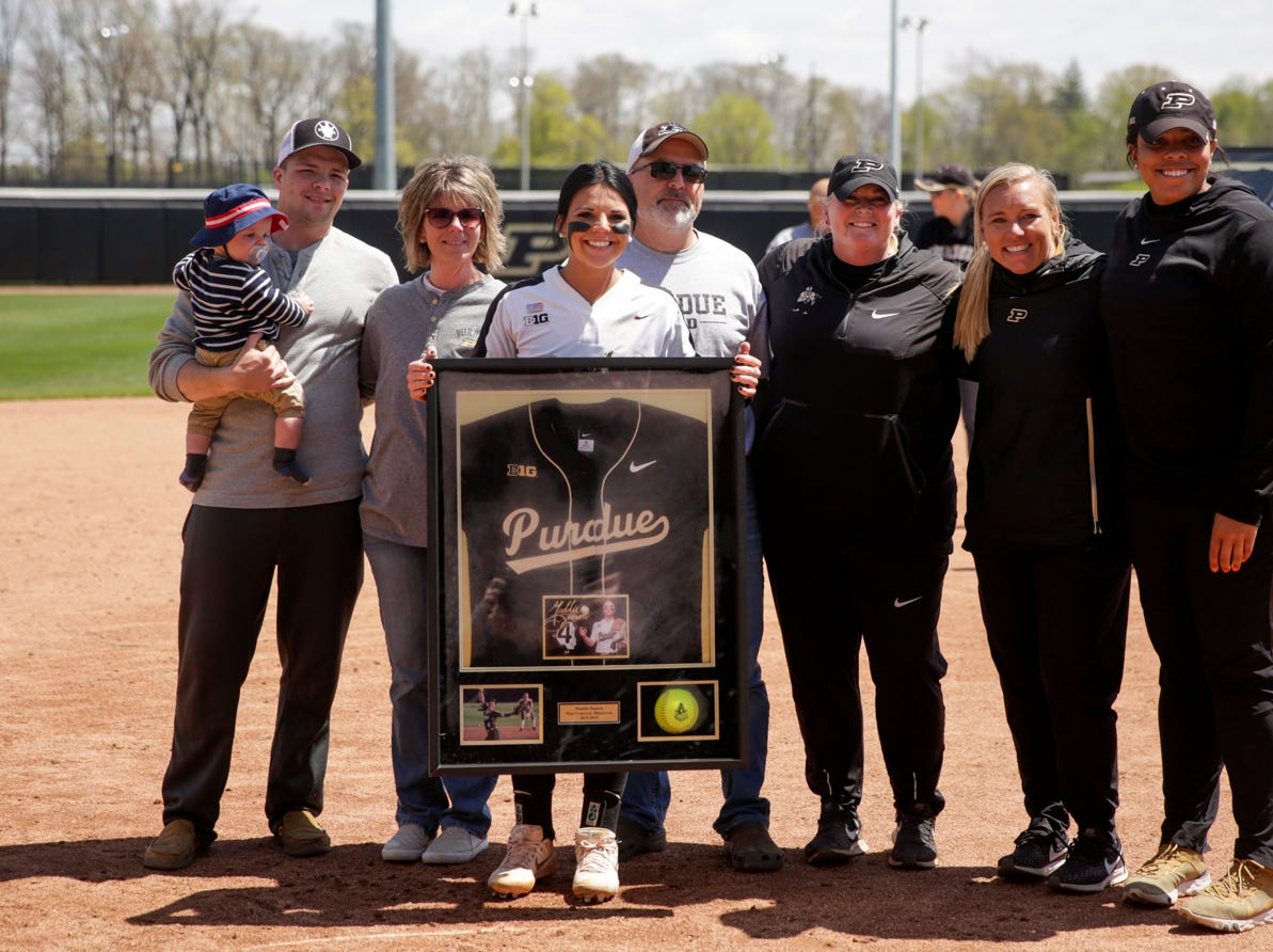 Purdue senior Maddie Damon (4) poses for photos with her family and Purdue head coach Boo De Oliveira during senior night ceremonies, Sunday, April 28, 2019 at Bittinger Stadium in West Lafayette.