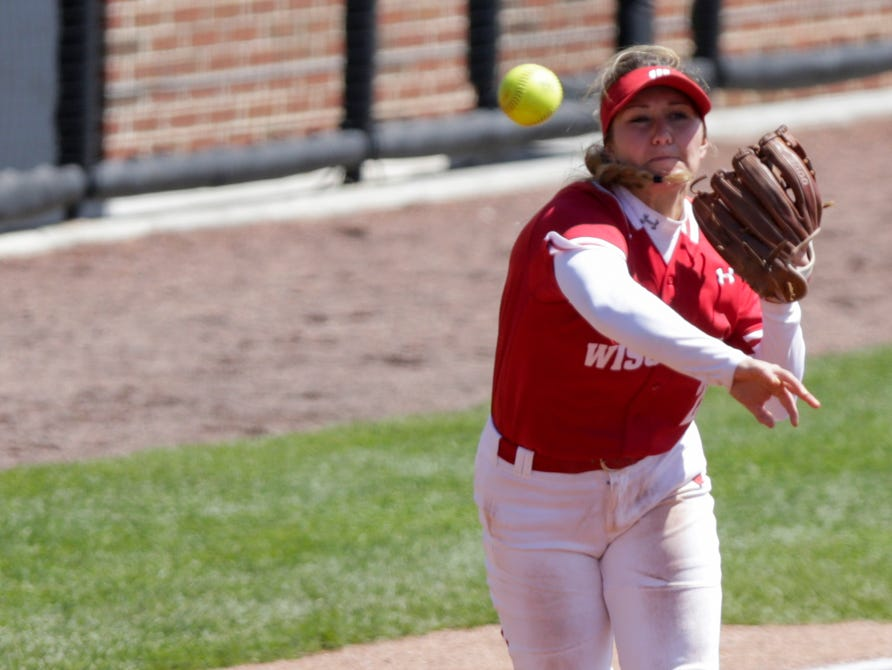 Wisconsin third baseman Jordan Little (25) throws to first during the second inning of a NCAA softball game, Sunday, April 28, 2019 at Bittinger Stadium in West Lafayette. Wisconsin won, 4-1.