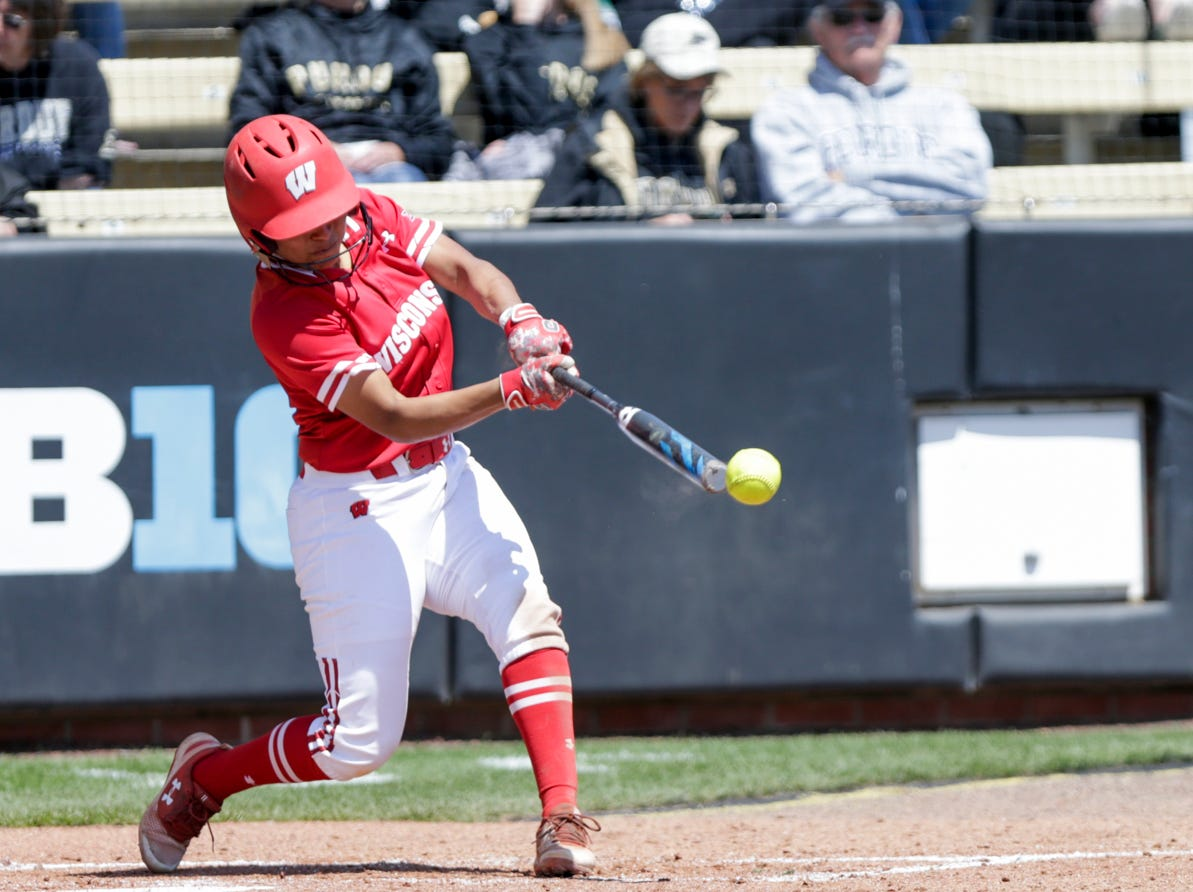 Wisconsin catcher Taylor Johnson (21) connects during the fifth inning of a NCAA softball game, Sunday, April 28, 2019 at Bittinger Stadium in West Lafayette. Wisconsin won, 4-1.