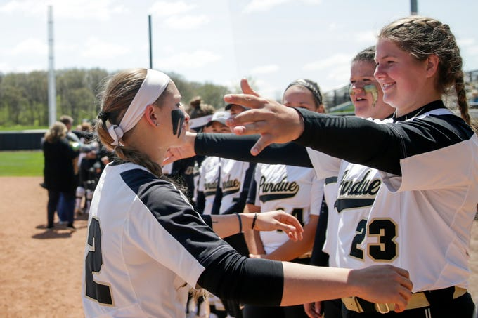 Purdue senior Jenny Behan (12) embraces Purdue pitcher Sydney Bates (23) during senior night ceremonies, Sunday, April 28, 2019 at Bittinger Stadium in West Lafayette.