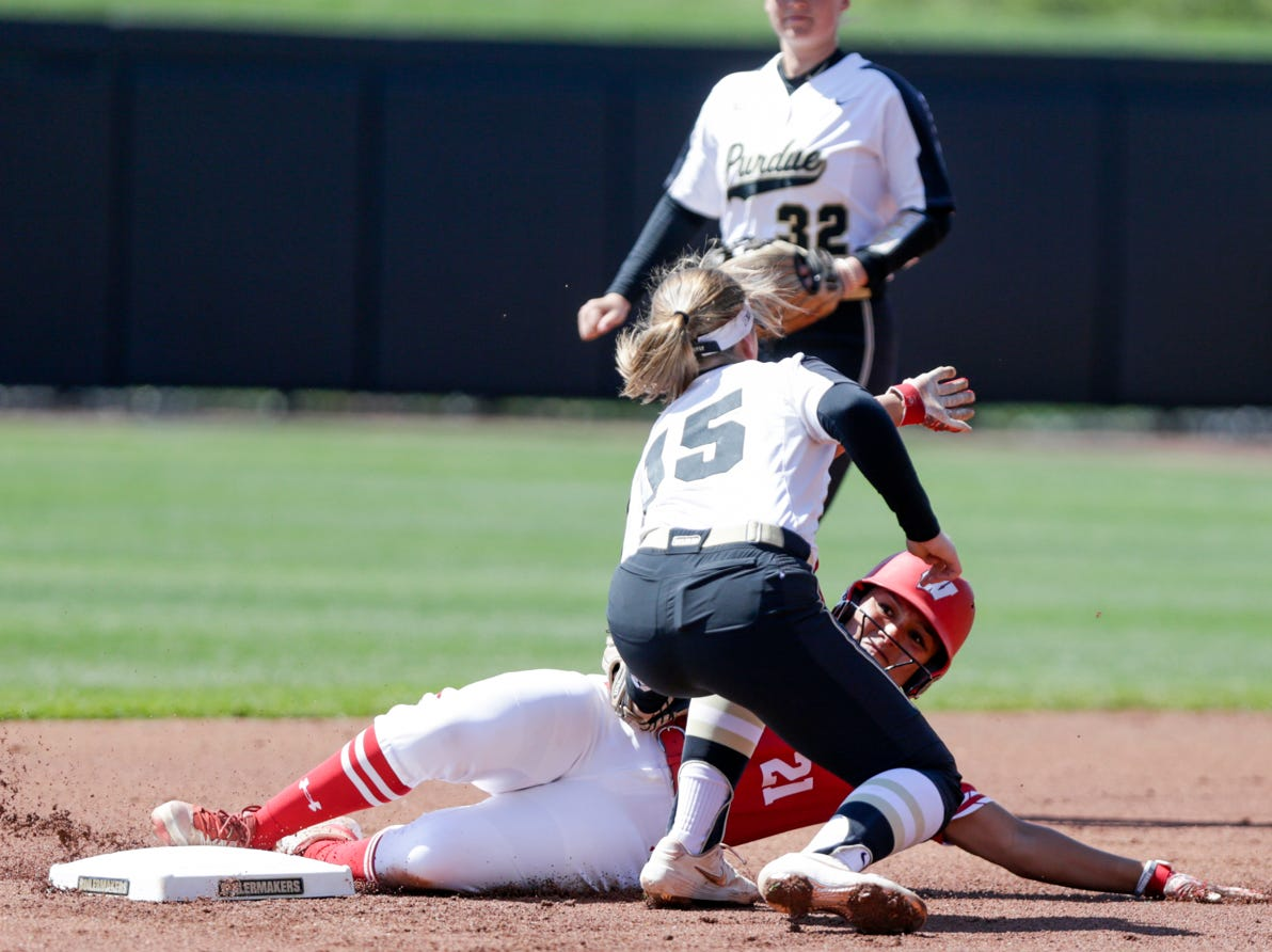 Purdue short stop Rachel Becker (15) tags Wisconsin catcher Taylor Johnson (21) as she slides into second during the first inning of a NCAA softball game, Sunday, April 28, 2019 at Bittinger Stadium in West Lafayette. Wisconsin won, 4-1.