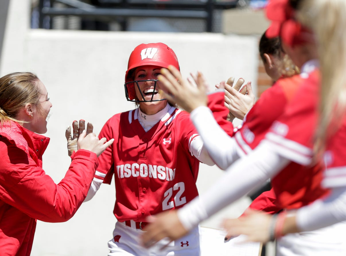 Wisconsin outfielder Gabby Scherle (22) celebrates in the Wisconsin dugout after scoring a run during the fifth inning of a NCAA softball game, Sunday, April 28, 2019 at Bittinger Stadium in West Lafayette. Wisconsin won, 4-1.