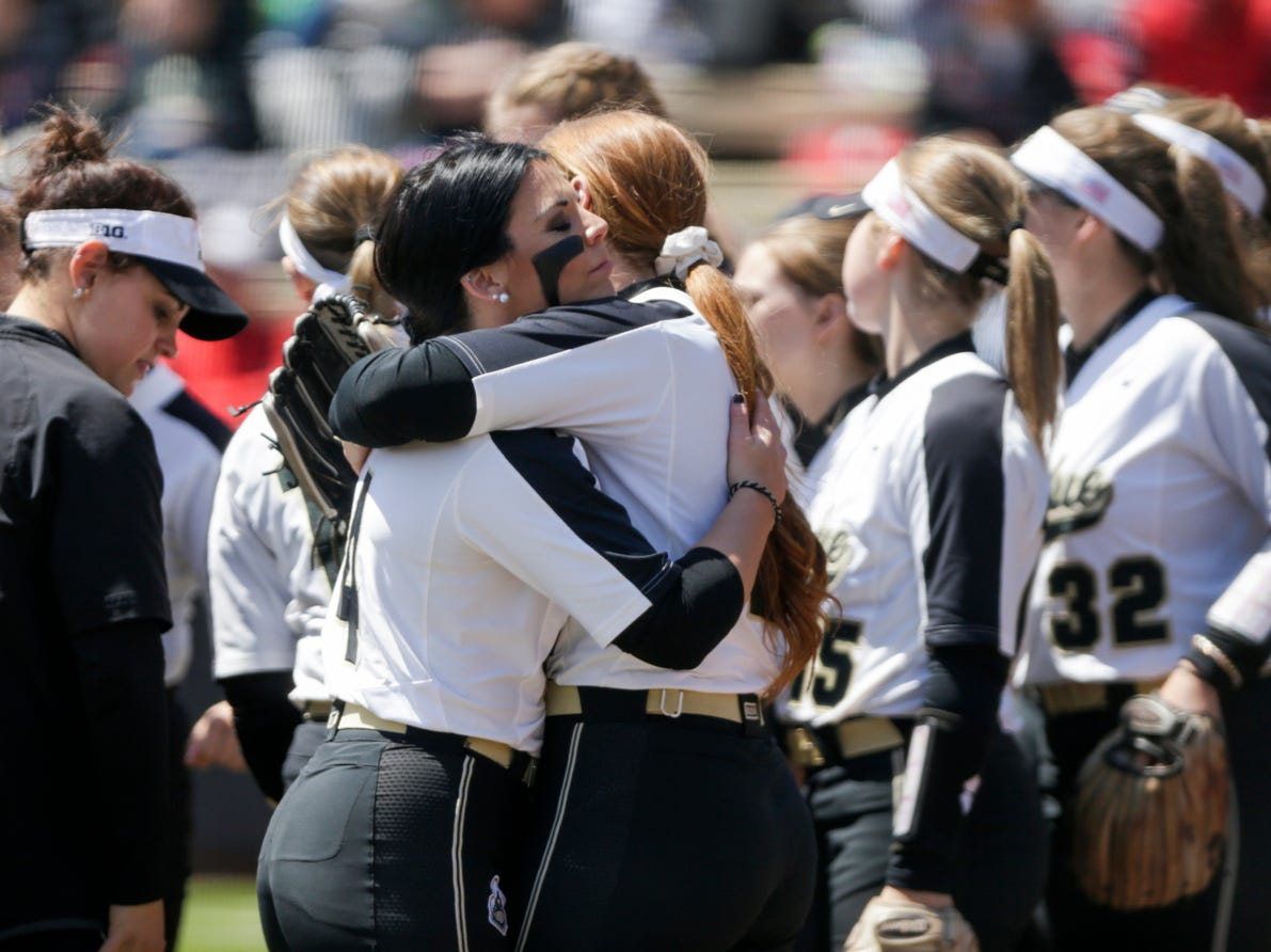 Purdue left fielder Mallory Baker (2) and Purdue pitcher Maddie Damon (4) embrace during the seventh inning of a NCAA softball game, Sunday, April 28, 2019 at Bittinger Stadium in West Lafayette. Wisconsin won, 4-1.