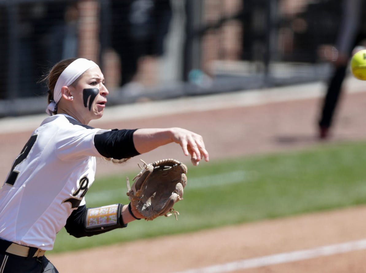 Purdue third baseman Jenny Behan (12) throws to first during the fourth inning of a NCAA softball game, Sunday, April 28, 2019 at Bittinger Stadium in West Lafayette. Wisconsin won, 4-1.