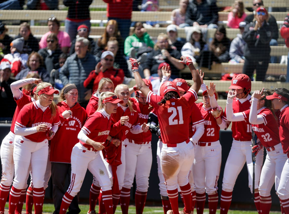 The Wisconsin dugout celebrates Wisconsin catcher Taylor Johnson (21) after hitting a two-run home run during the seventh inning of a NCAA softball game, Sunday, April 28, 2019 at Bittinger Stadium in West Lafayette. Wisconsin won, 4-1.