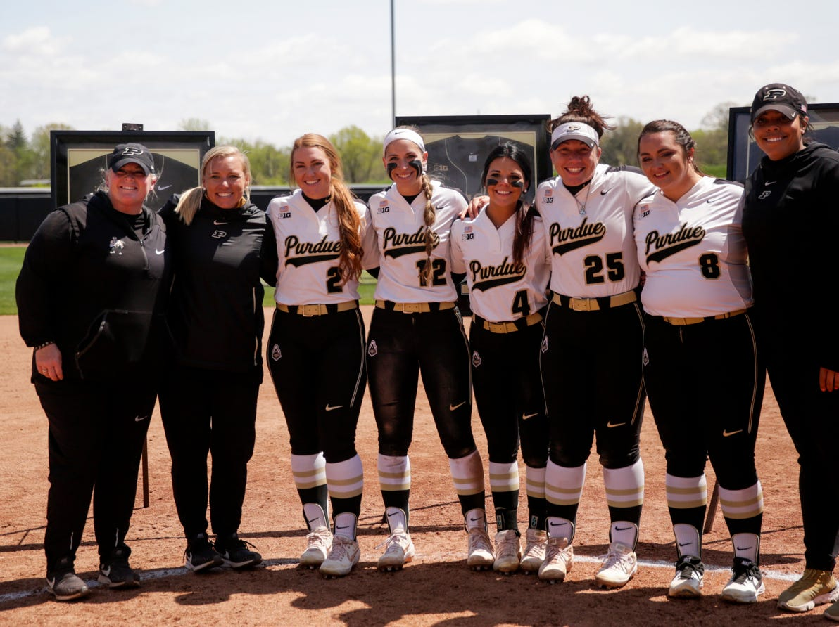 From left, Purdue head coach Boo De Oliveira, assistant coach Adrienne Clark, Purdue senior Mallory Baker (2), Purdue senior Jenny Behan (12), Purdue senior Maddie Damon (4), Purdue senior Lexi Huffman (25), Purdue senior Kaitlynn Moody (8) and assistant coach Dorian Shaw pose for a photo during senior night ceremonies, Sunday, April 28, 2019 at Bittinger Stadium in West Lafayette.