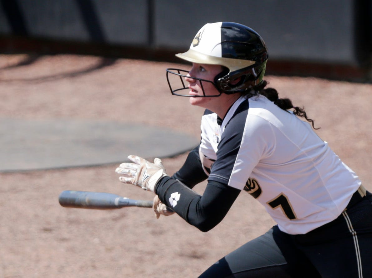 Purdue center fielder Kasey Wilhoit (7) watches her swing during the first inning of a NCAA softball game, Sunday, April 28, 2019 at Bittinger Stadium in West Lafayette. Wisconsin won, 4-1.