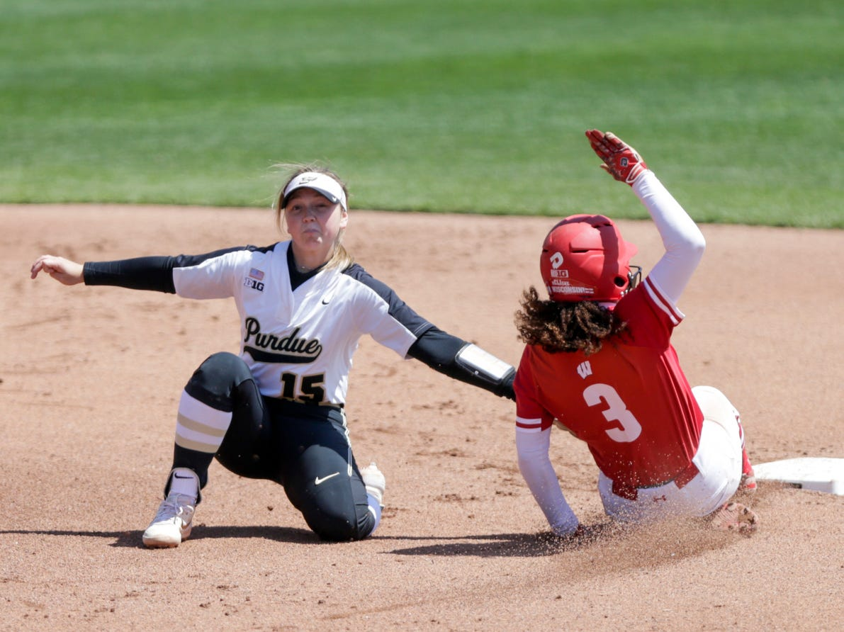Purdue short stop Rachel Becker (15) tags out Wisconsin left fielder Tyra Turner (3) during the fourth inning of a NCAA softball game, Sunday, April 28, 2019 at Bittinger Stadium in West Lafayette. Wisconsin won, 4-1.