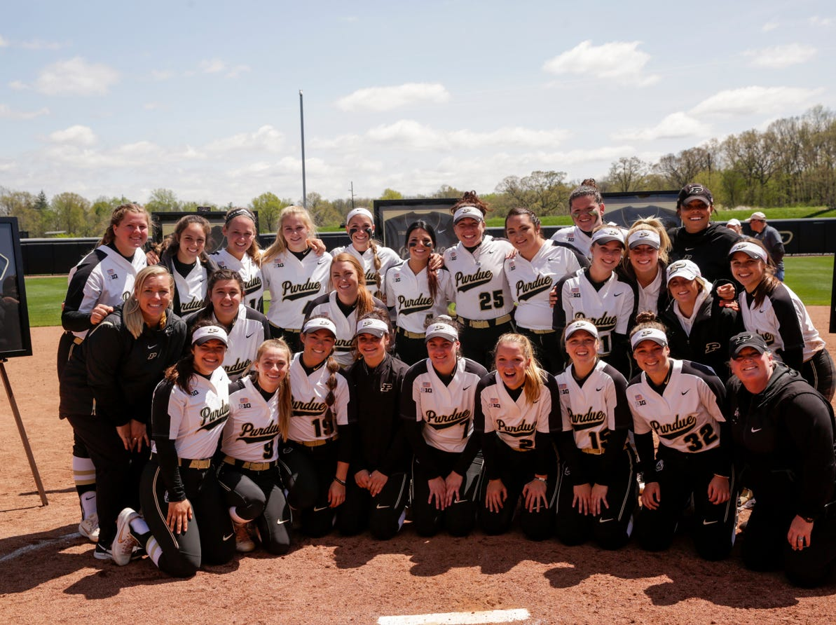 The Purdue dugout poses for a photo during senior night ceremonies, Sunday, April 28, 2019 at Bittinger Stadium in West Lafayette.