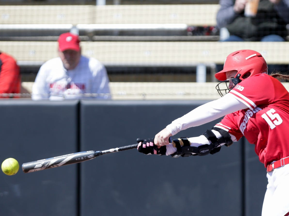Wisconsin first baseman Kayla Konwent (15) connects during the first inning of a NCAA softball game, Sunday, April 28, 2019 at Bittinger Stadium in West Lafayette. Wisconsin won, 4-1.