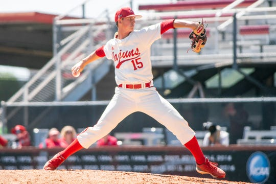 """UL's pitcher Jacob Schultz winds up a throw to the batter as the Ragin' Cajuns take on the Texas State Bobcats at M.L. """"Tigue"""" Moore Field on Sunday."""