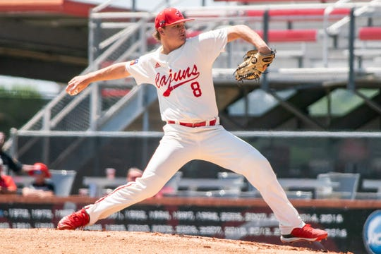 """UL's pitcher Blake Schultz throws to the batter as the Ragin' Cajuns take on the Texas State Bobcats at M.L. """"Tigue"""" Moore Field on Sunday."""