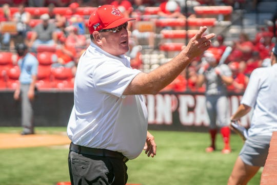 UL's head softball coach Gerry Glasco talks to his players from outside the dugout as the Ragin' Cajuns take on the Coastal Carolina Chanticleers during their Senior Day game at Yvette Girouard Field on Sunday, April 28, 2019.