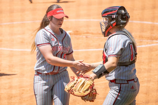 UL's Summer Ellyson (left) and Lexie Comeaux (right) commend one another after the inning as the Ragin' Cajuns take on the Coastal Carolina Chanticleers. Ellyson fashioned a one-hit shutout with 16 strikeouts as the Cajuns defeated ULM Thursday.