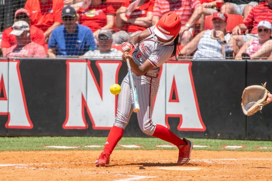 UL's Raina O'Neal makes contact with the pitch as the Ragin' Cajuns take on the Coastal Carolina Chanticleers during their Senior Day game at Yvette Girouard Field on Sunday.