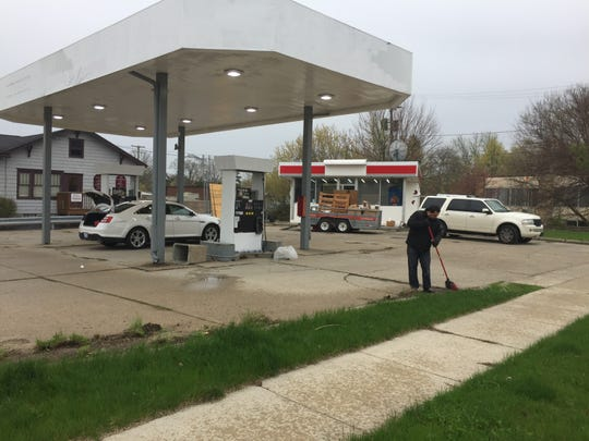 Fadi Kajy, owner of a closed gas station property at 401 E. Grand River Ave. in Howell the city declared a dangerous building was cleaning up the property Monday, April 29, 2019.