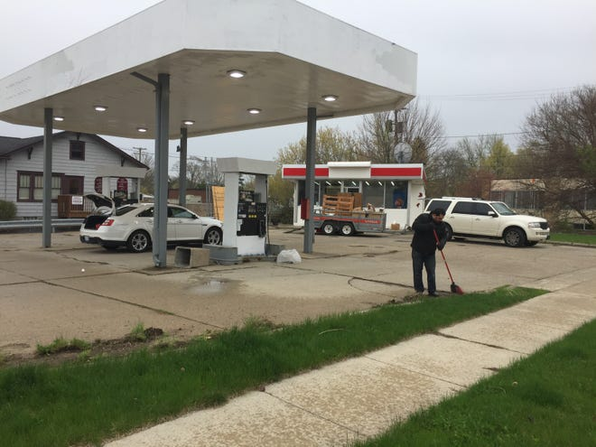 Fadi Kajy, owner of a closed gas station property at 401 E. Grand River Ave. in Howell was cleaning up the property Monday, April 29, 2019.