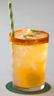 One of the Pine Room's specialty drinks, the County Line, is made with El Jimador Silver (tequila), grapefruit juice, grapefruit shrub syrup, lime and soda water. The glass is lined with smoked paprika salt. April 24, 2019