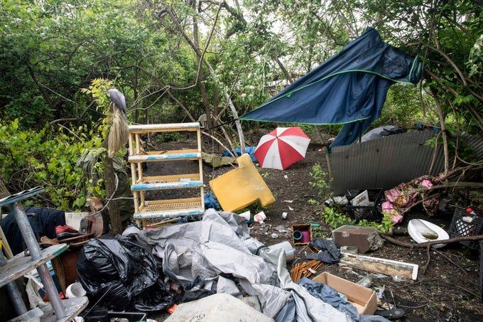 CSX demolishes Louisville homeless camp along railroad tracks