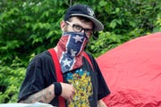 A homeless camper and settlement leader known as Playboy was the last man standing on Monday at the camp on CSX property.