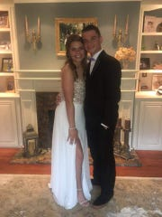 Makayla Hostetler and Colin Campbell pose for a photo on the night of their senior prom. Hostetler was killed and Campbell was critically injured when they were struck by an SUV in July of 2018.