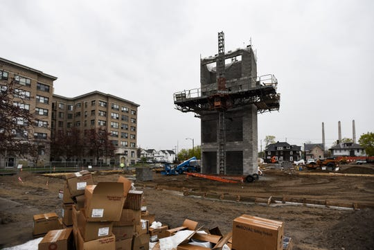 Signs that construction has begun on the $25 million project — dubbed Metro Place are seen Monday, April 29, 2019.  The site was the former Downtown YMCA at 301 W. Lenawee St. near Townsend Street and Reutter Park.  The new 122,130 square-foot project will have 145 loft apartment units including 30 studio units; 69 one-bedroom, one-bath units; 29 two-bedroom, one-bath units; and 17 two-bedroom, two-bath units.