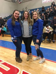 Makayla Hostetler (middle) poses for a photo with her two best friends, Alexis Bahl  (left) and Mykenzie Lochner (right).  The three girls coached the elementary-aged Mason Junior Bulldogs cheer team. Hostetler was struck and killed by a vehicle in July of 2018.