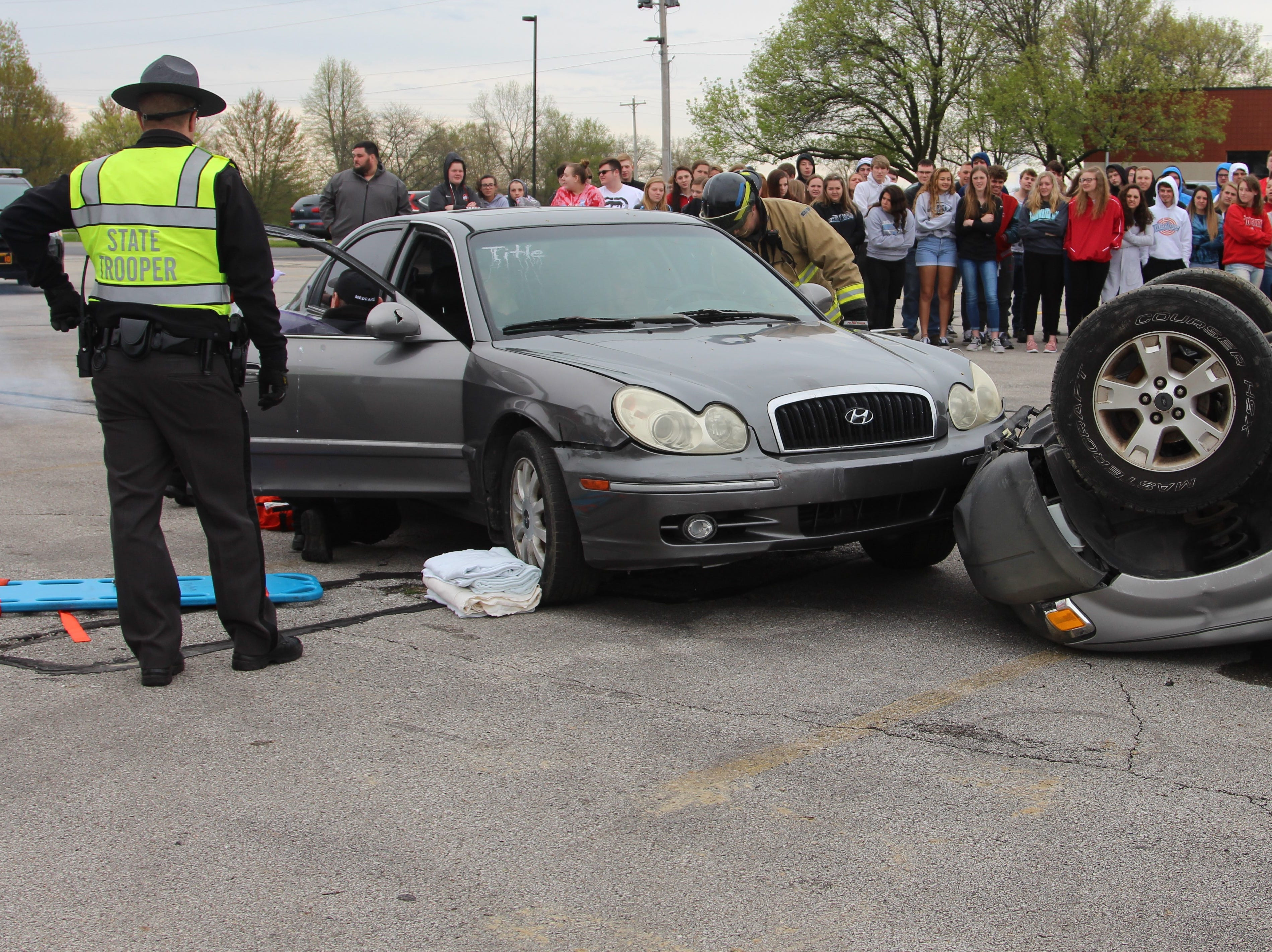 Members of the Salt Rock Fire Department, Survival Flight, the Ohio Highway Patrol and the Marion County Sheriff's Office took part in a mock crash at Ridgedale Jr./Sr. High School Monday morning.