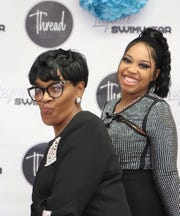 Yolanda Stripling (left) and LaTarica Stripling (right) smile together during an event for LaTarica's Thread Collection business.