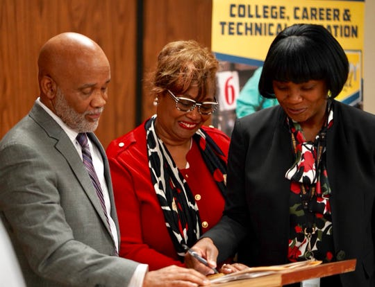 Principal Leroy McClain of Southwest Career & Technology Center, Greater Memphis Chamber President and CEO Beverly Robertson and Docia Generette-Walker, Shelby County Schools CCTE Director celebrate workforce training partnership hoping to train and certify 6,000 students each school year.
