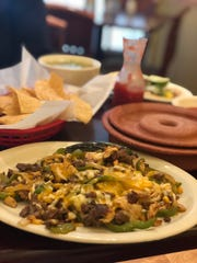The steak and chicken fajitas at Las Delicias Mexican Bar & Grill.