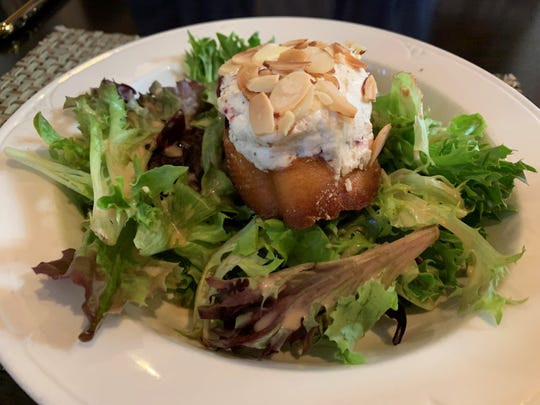 The warm almond-crusted goat cheese salad from Marek's, Marco Island.