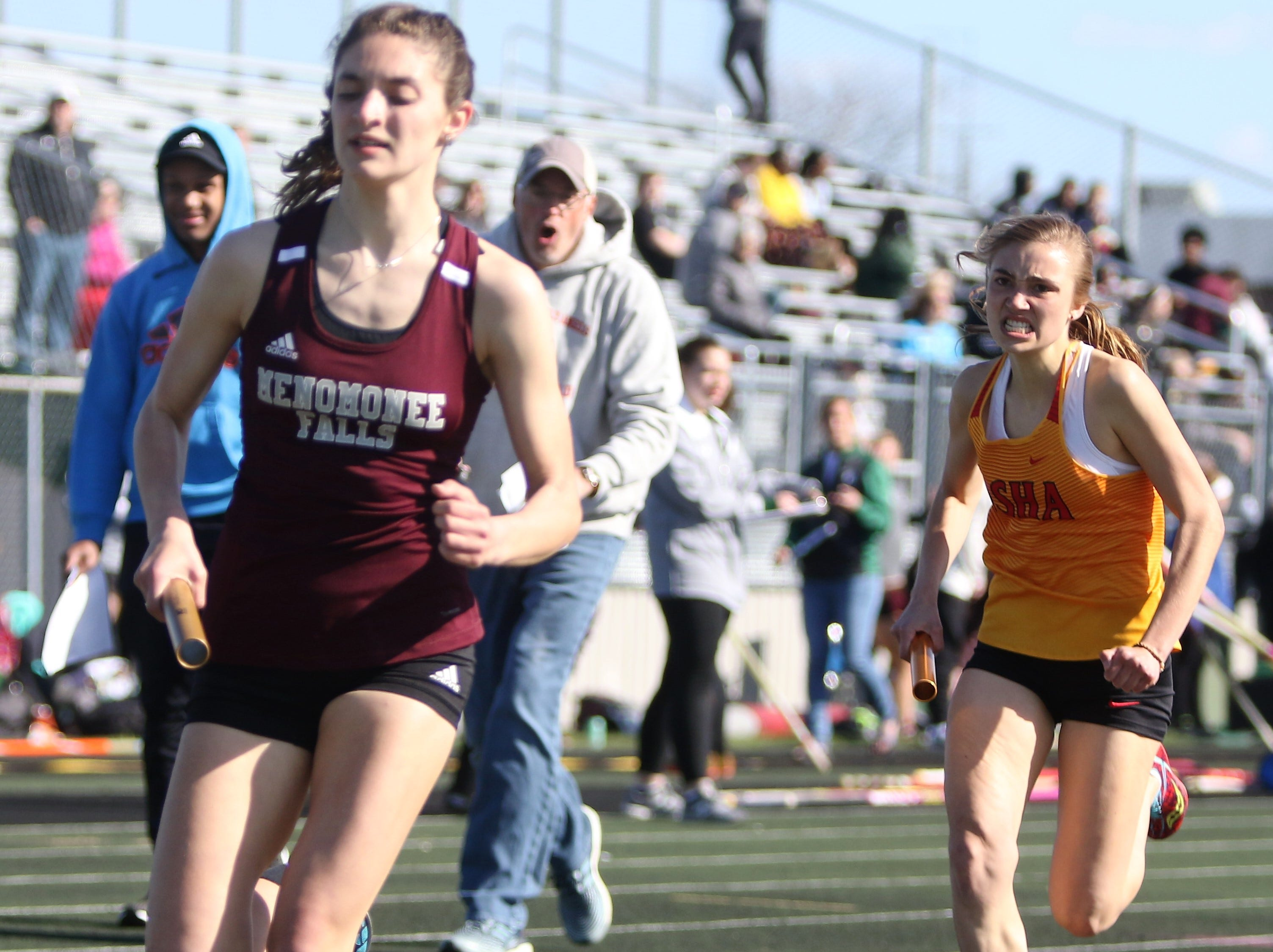 Bonnie Raechel Beres of DSHA chases down a Menomonee Falls runner during the 3200 meter relay at the Dan Benson Invitational at Wauwatosa West on April 26, 2019.
