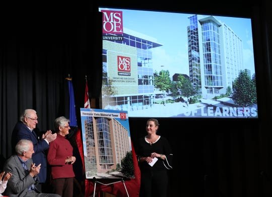 Milwaukee Mayor Tom Barrett, left, looks on as MSOE Regent Eckhart Grohmann, accompanied by MSOE Regent Pamela Viets, center, and her daughter Hillary Viets Bowser, unveil a rendering of the Hermann Viets Memorial Tower.