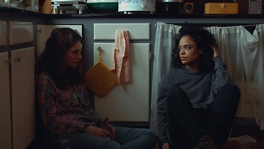 "Lily James (left) and Tessa Thompson play sisters trying to dig themselves out of the hole their late mother left for them in ""Little Woods."""