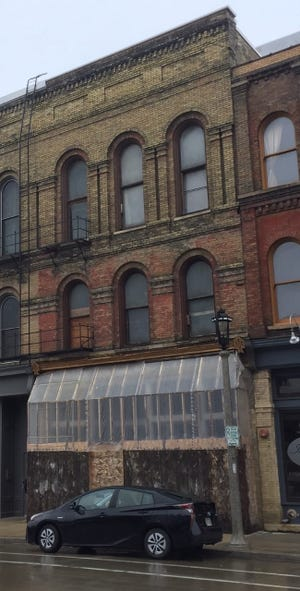A three-story building in Walker's Point would be renovated for a mix of uses under plans pending before city officials.