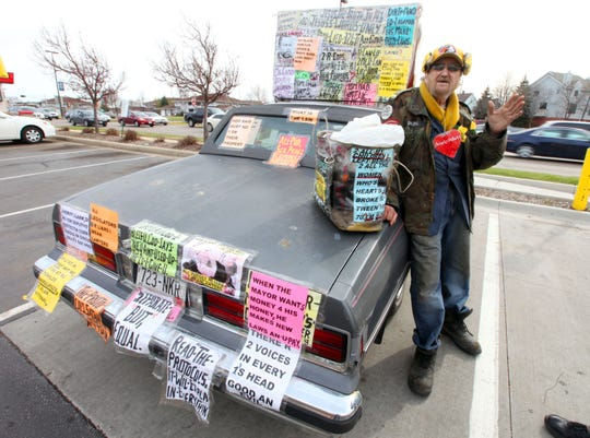 Brother Ron stands near his Jesus mobile outside a McDonald's restaurant at 43rd Street and National Avenue in Milwaukee in 2014.