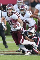 Texas A&M tight end Jace Sternberger (81) battles for yardage against South Carolina last season.