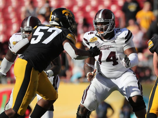 Mississippi State Bulldogs offensive lineman Elgton Jenkins (74) blocks as Iowa Hawkeyes defensive end Chauncey Golston (57) rushes during the second half in the 2019 Outback Bowl at Raymond James Stadium on Jan. 1, 2019 in Tampa, FL. The Packers selected Jenkins with the 44th overall pick (second round).