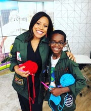 Today host Sheinelle Jones and Jonah Larson wear Jonah's crochet utility jackets and hold yarn and crochet hooks.