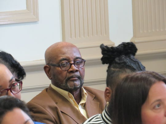 Former bus driver Hudy Muldrow sits in the courtroom gallery awaiting his arraignment on two counts of vehicular homicide and 16 assault charges, in Morristown Superior Court in Morristown,  April 29, 2019. Muldrow was driving a Paramus school bus when he crashed on Route 80 in Mount Olive on May 17, 2018. A student and a teacher died.