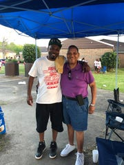 Jay Mayes poses with Cedric Williams during the 9th annual Highland Village community reunion. Both are former residents.