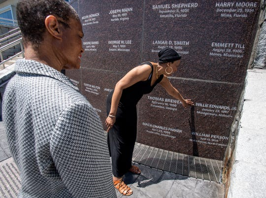 Malinda Edwards, left, and Mildred Betts, daughters of Willie Edwards, Jr., visit the new monument to those who were victims of racial terror lynchings or violence during the 1950s at the Peace and Justice Memorial Center in Montgomery, Ala. Their father was murdered in 1957 in Montgomery.