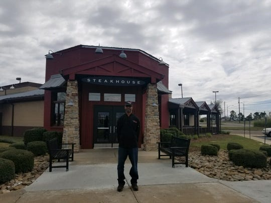 Reginald Parker is grill master at Longhorn Steakhouse at 4095 East Boulevard in Montgomery.